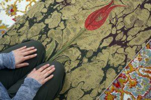 A girl is offers a prayer on Luxury Prayer mat